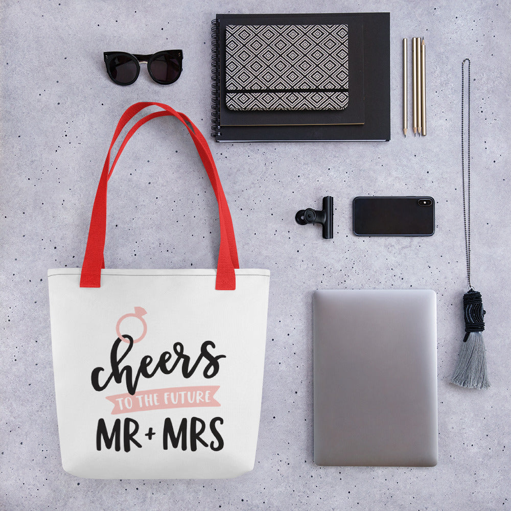 wedding gift to new couple.  tote bag with red strap that says Cheers to the new Mr. and Mrs.