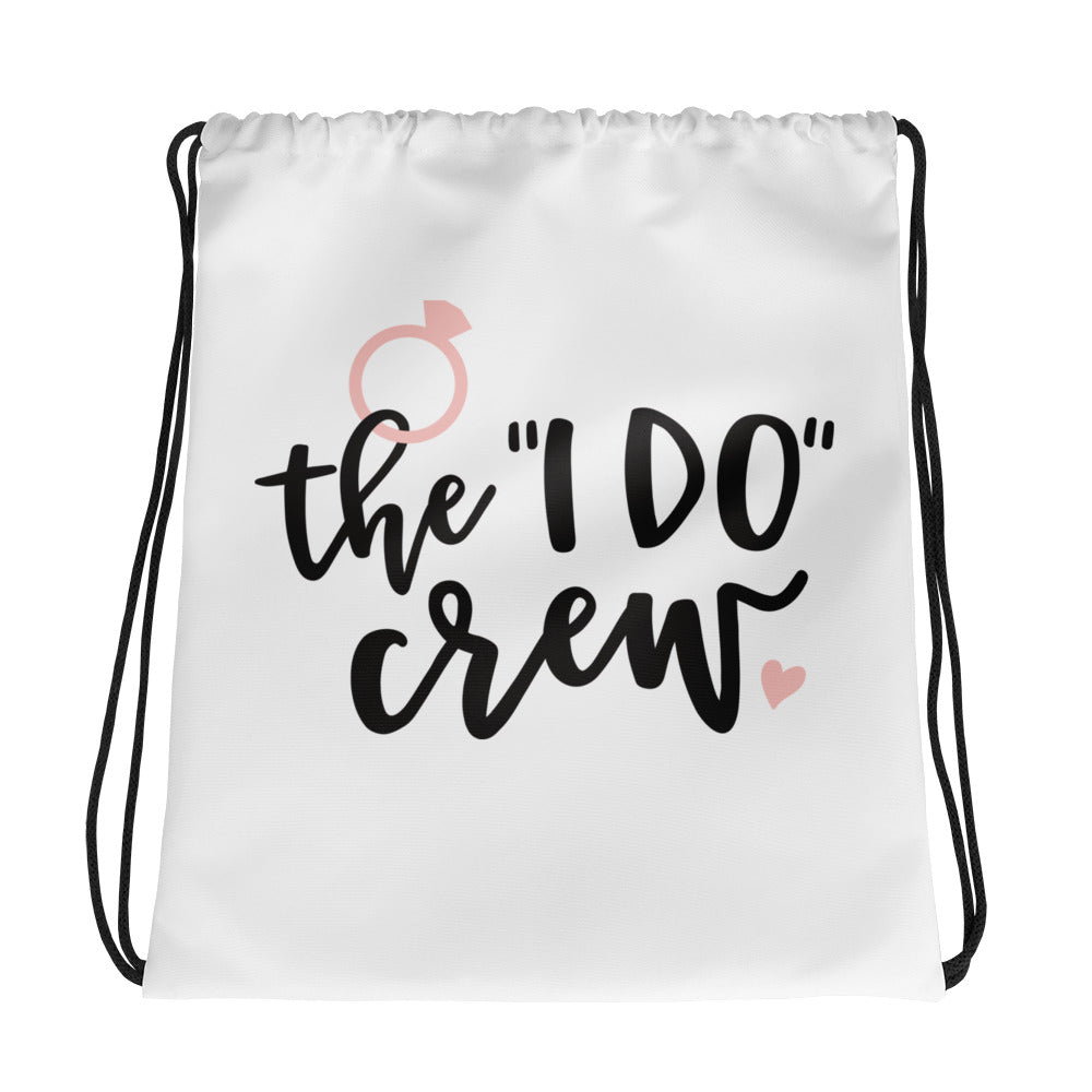 Wedding party white bag featuring the words The I Do Crew in black font with a pink ring.