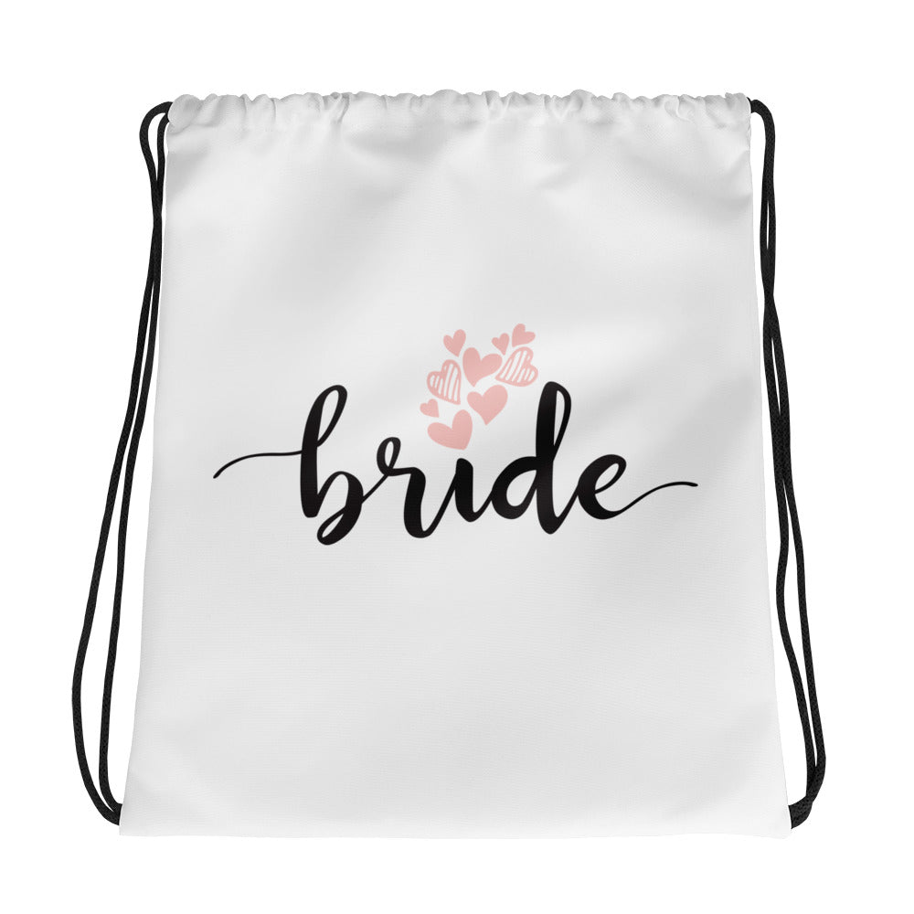 white drawstring bag for bride.  carry bag with Bride written on it.