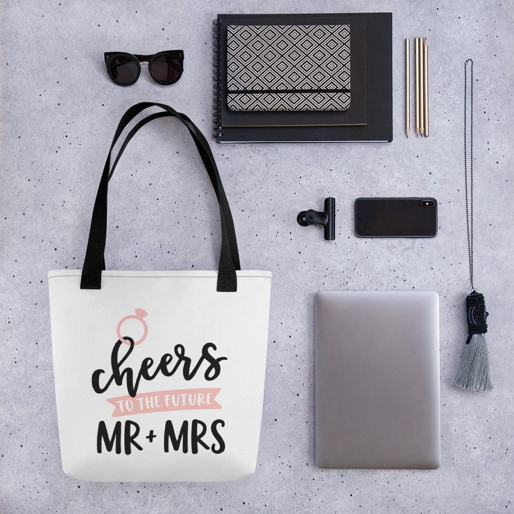 Wedding tote bag gift for wedding.  cheers to the mr. and mrs. on white background with black writing.