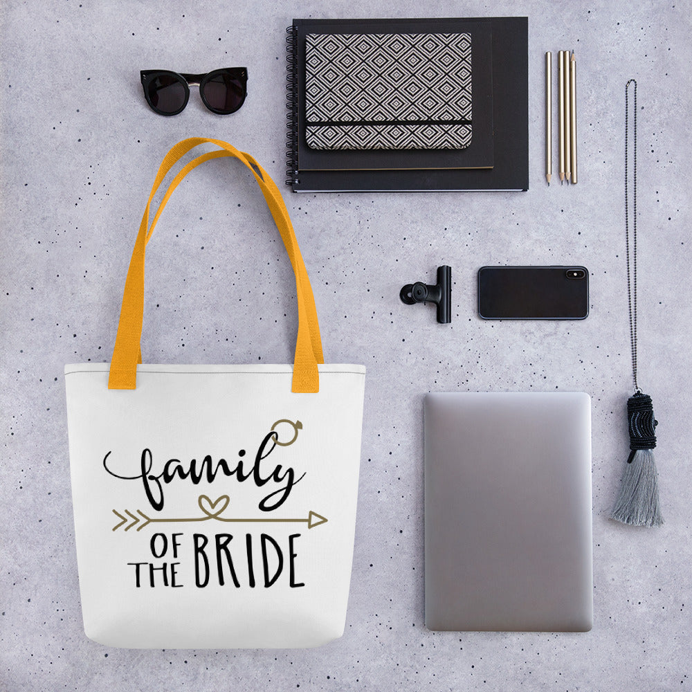 white wedding tote bag with Family of the Bride written in cute black font with gold lettering.  Gold arrow above bride.
