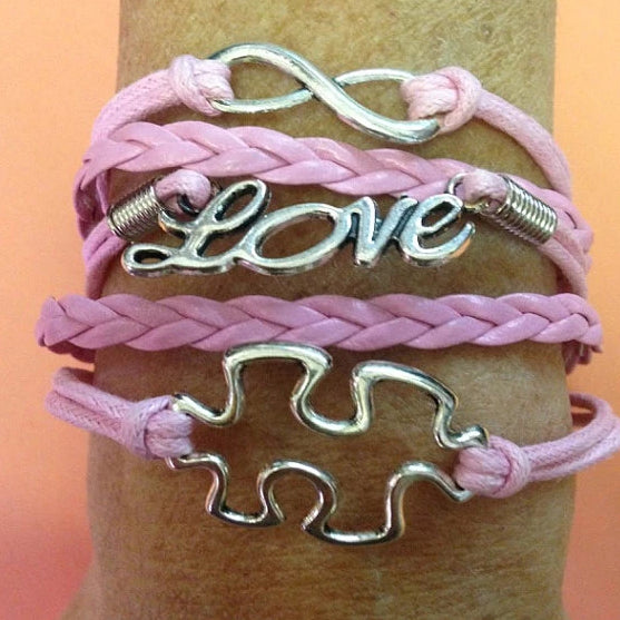 Pink puzzle piece bracelet with infinity sign and word love - The Missing Piece Puzzle Co