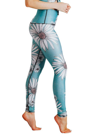 Yoga Democracy Women's Eco-friendly yoga full length leggings in flower child daisy print. USA made from post-consumer recycled plastic bottles. Sweat wicking, anti-microbial, and quick dry ultra-soft brushed fabric.