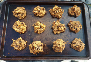 baking sheet with twelve chickpea raisin chocolate chip cookies