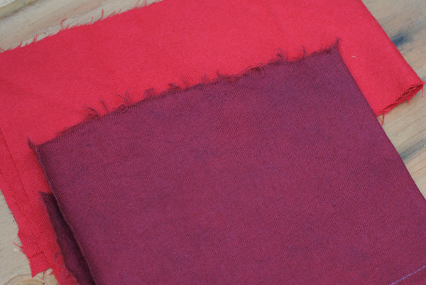 Red wool fabric overdyed with indigo to maroon