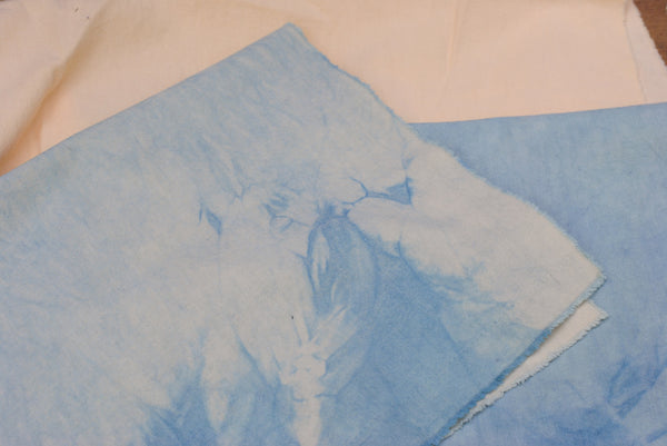Overdyed beige fabric with indigo