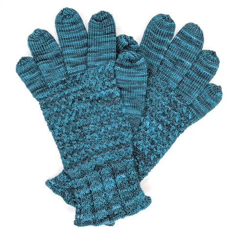 Lanark gloves knit in a teal variegated yarn