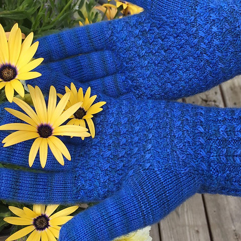 Bright blue Lanark gloves modeled with flowers