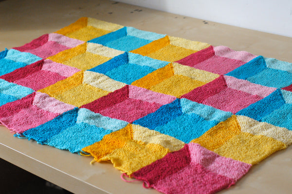 Brightly coloured baby blanket