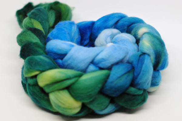 Coiled hand-dyed roving in blue-green gradient