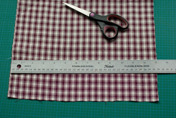 measuring fabric to cut