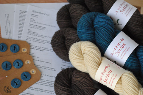 Knowlton coat knitting kit with hand-dyed yarn, hand-made buttons, and printed pattern