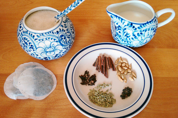 Milk, sugar, and spices for making chai tea