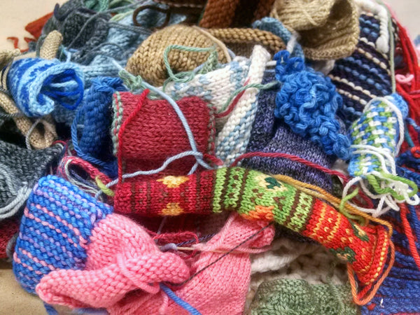 Big jumble of knitted swatches
