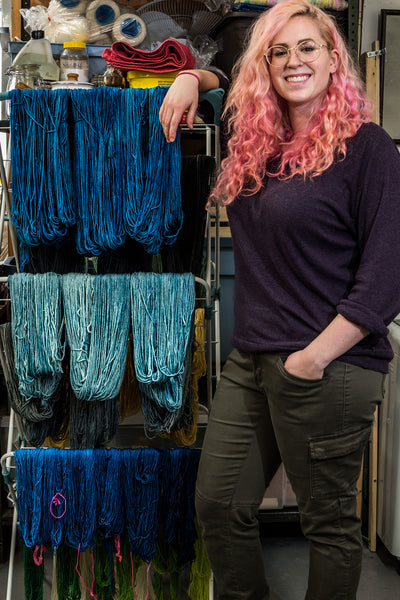 Sarah with dyed yarn hanging to dry