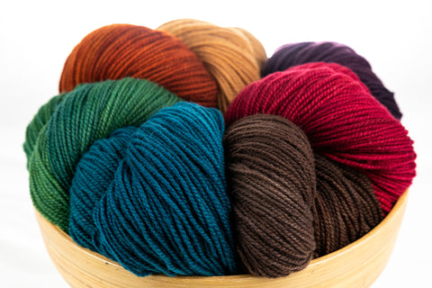 Bowl of Winfield hand-dyed yarn in rich colours