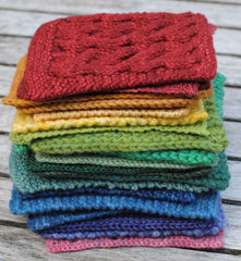 Rainbow of knit swatches stacked up