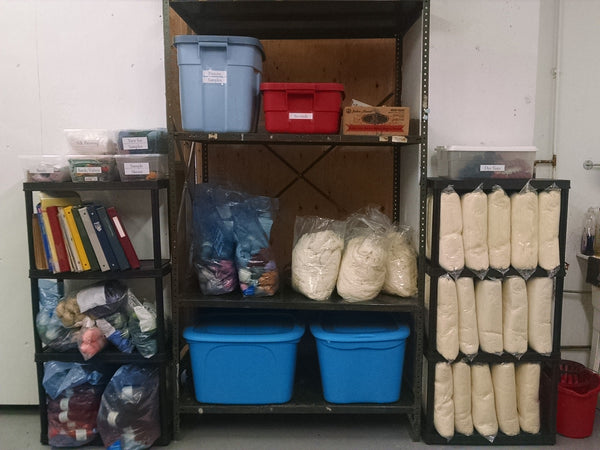 Undyed yarn on shelves