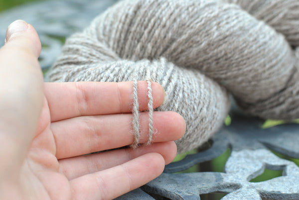 Hand-spun yarn showing texture and ply