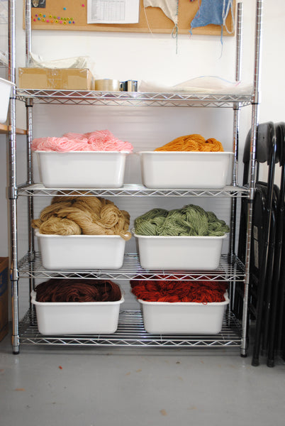 Bins of hand-dyed yarn