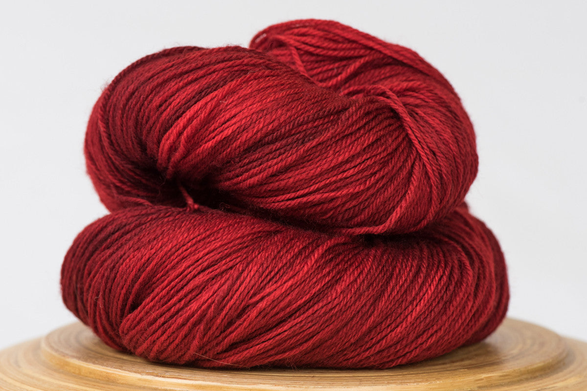 Canneberge semi-solid rich red fingering weight hand-dyed yarn