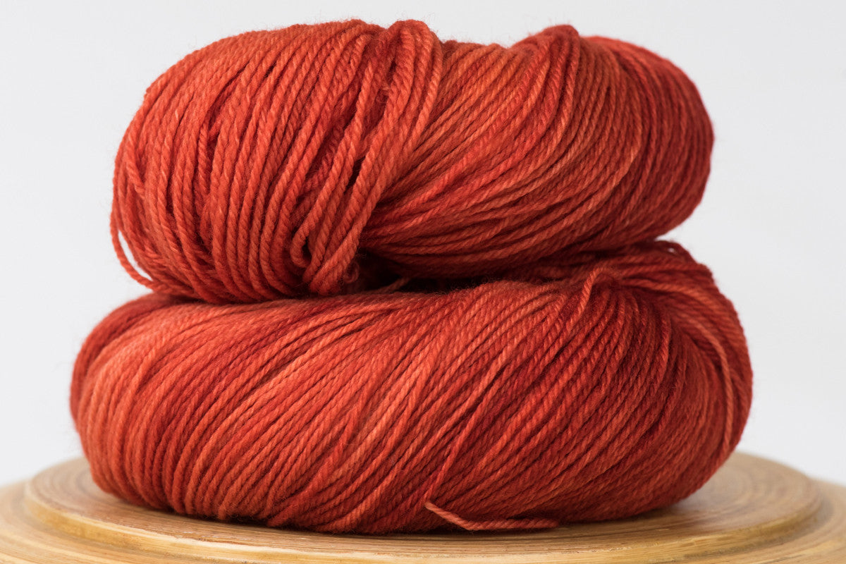Crushed chili tonal deep orange fingering weight hand-dyed yarn