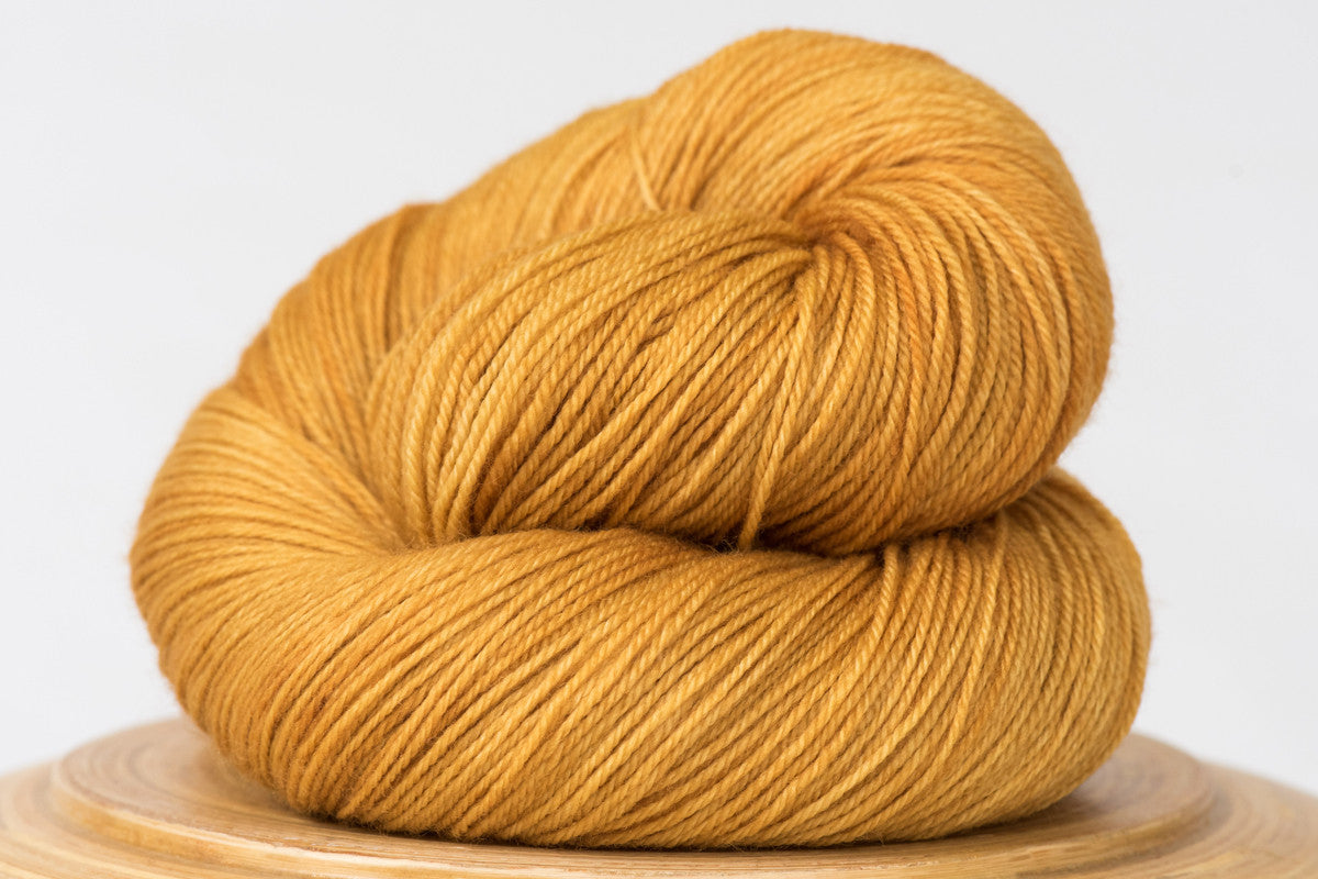 Harvest moon tonal gold fingering weight hand-dyed yarn