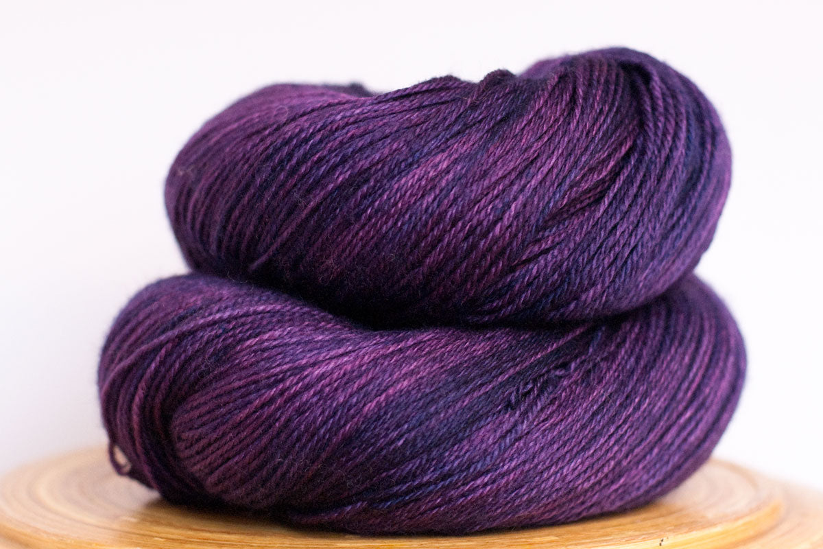 Purple rain semi-solid fingering weight hand-dyed yarn