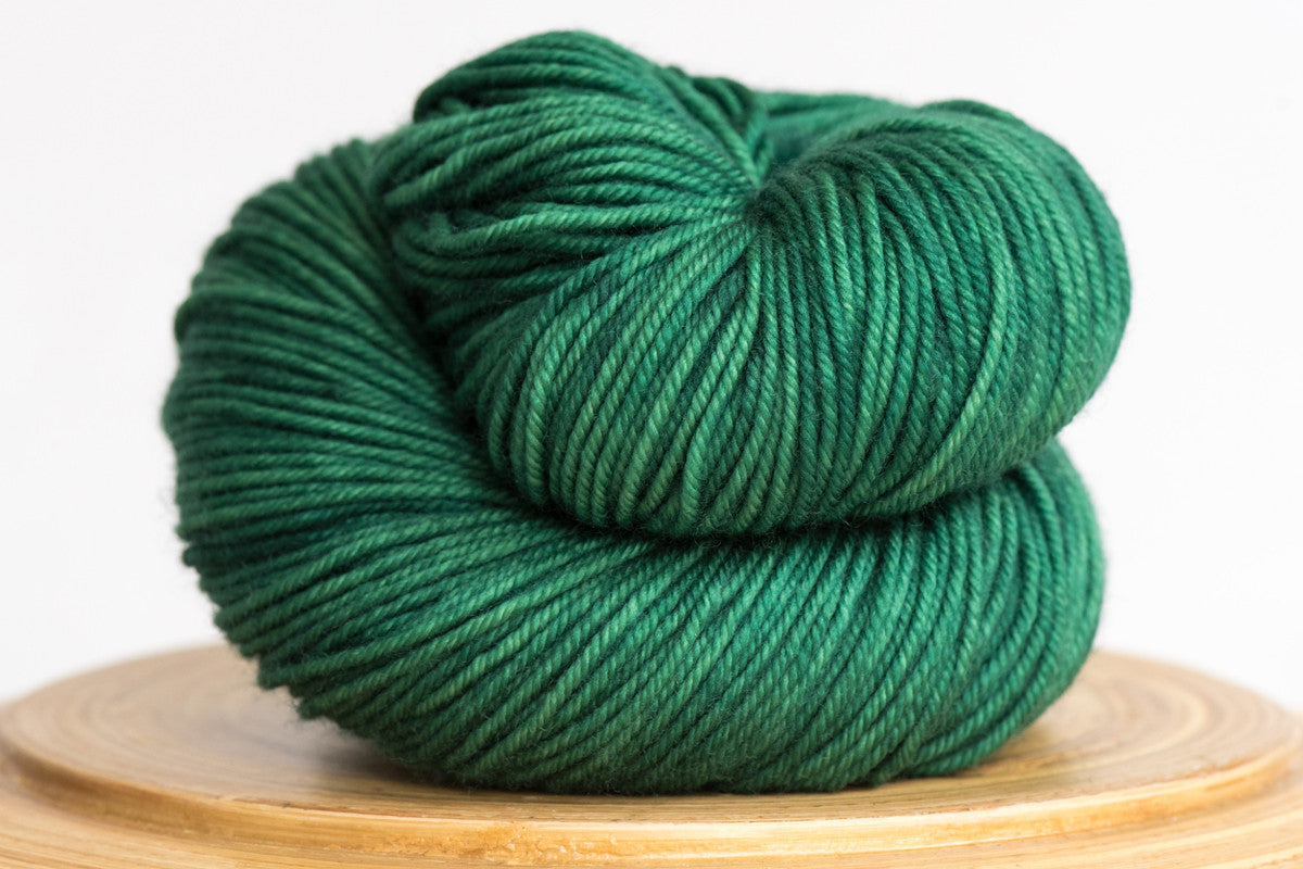 Emerald City vibrant green semi solid DK weight hand-dyed yarn