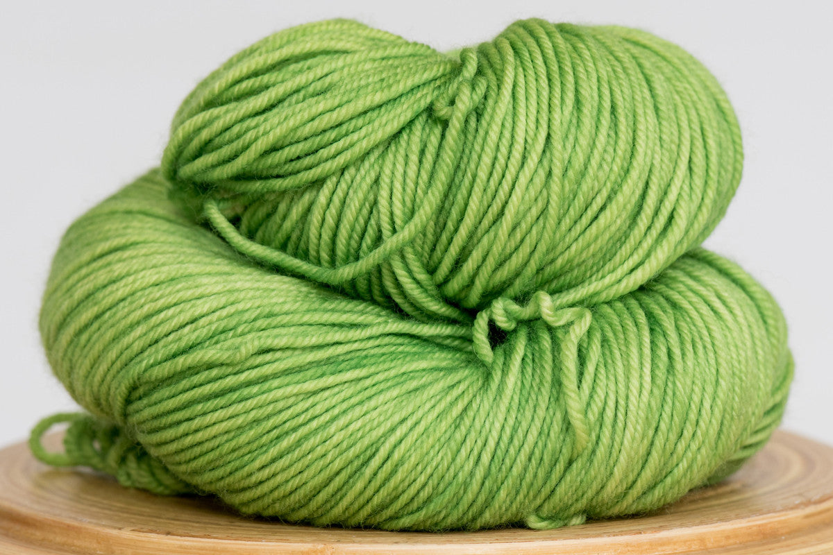 Grasshopper bright green semi solid DK weight hand-dyed yarn
