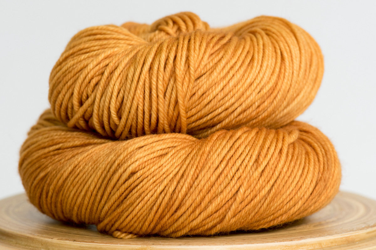 Harvest moon gold semi solid DK weight hand-dyed yarn