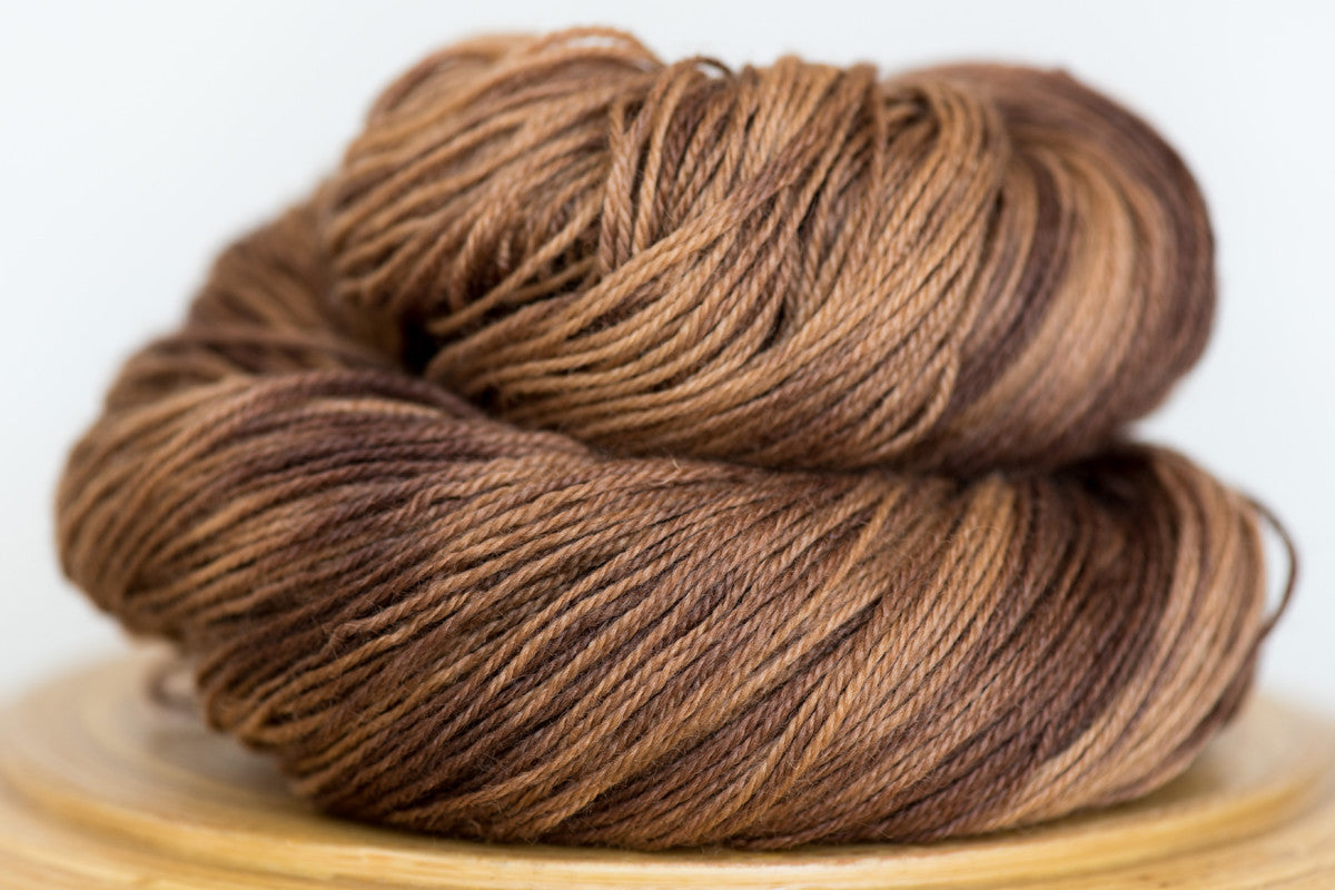 Pizzicato hand-dyed BFL sock yarn in Buckwheat