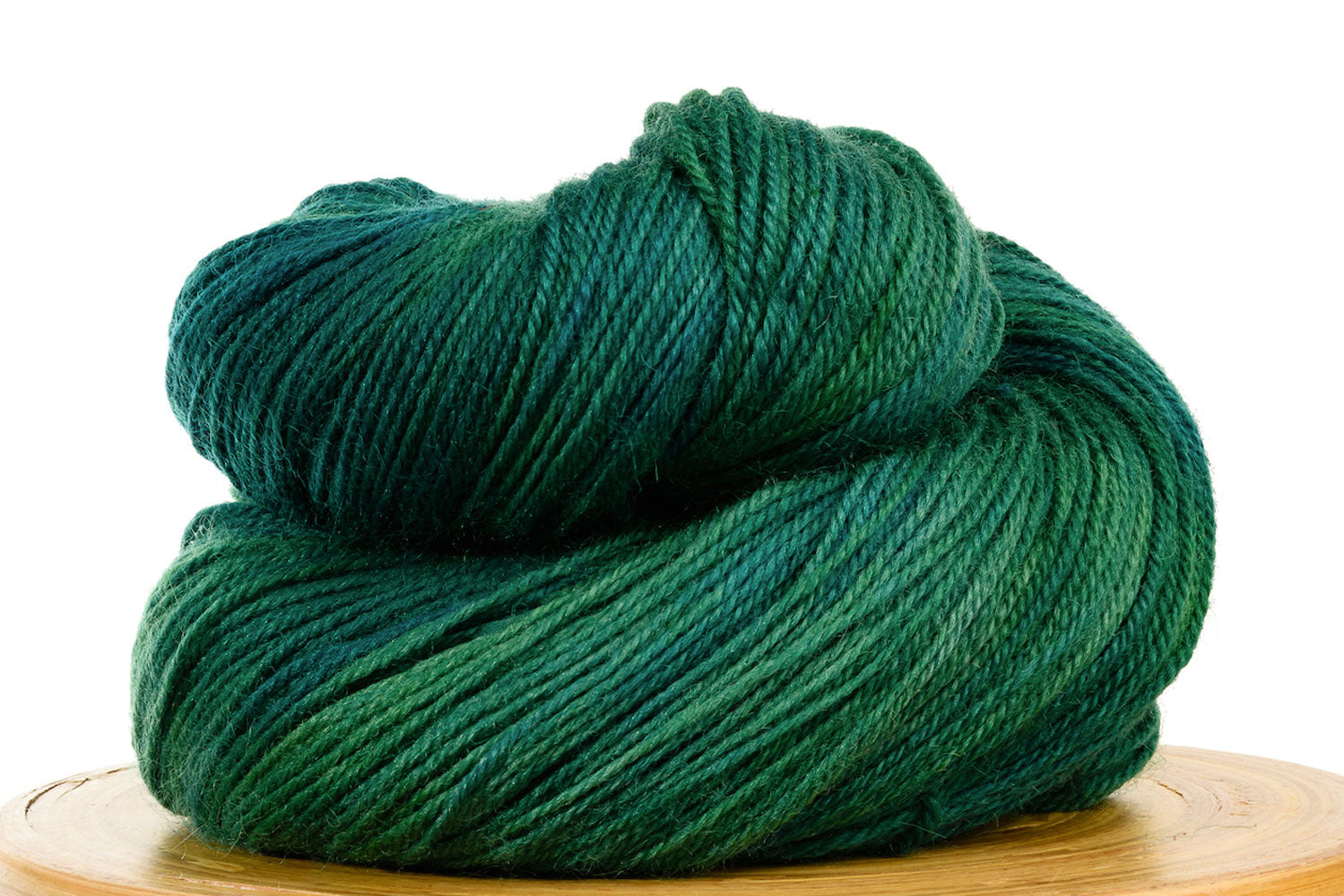 Pizzicato hand-dyed BFL sock yarn in Peacock