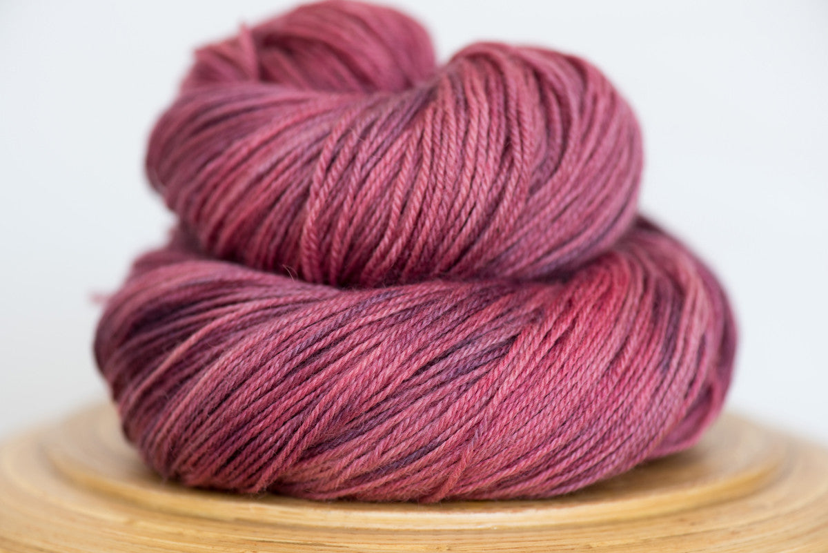 Pizzicato hand-dyed BFL sock yarn in Pink Clover