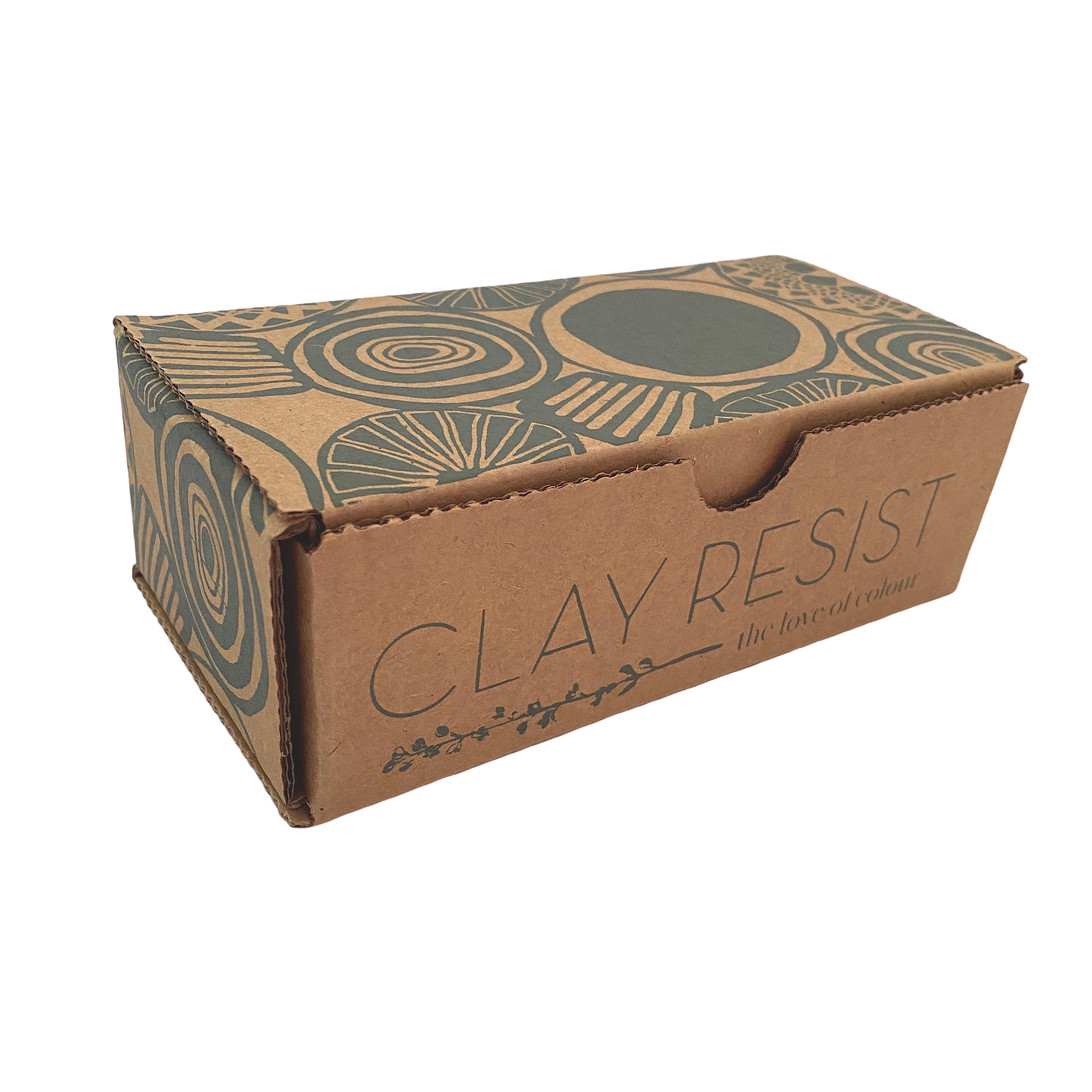 Cardboard box containing clay resist kit on white background. Box is printed with dark green circular motifs