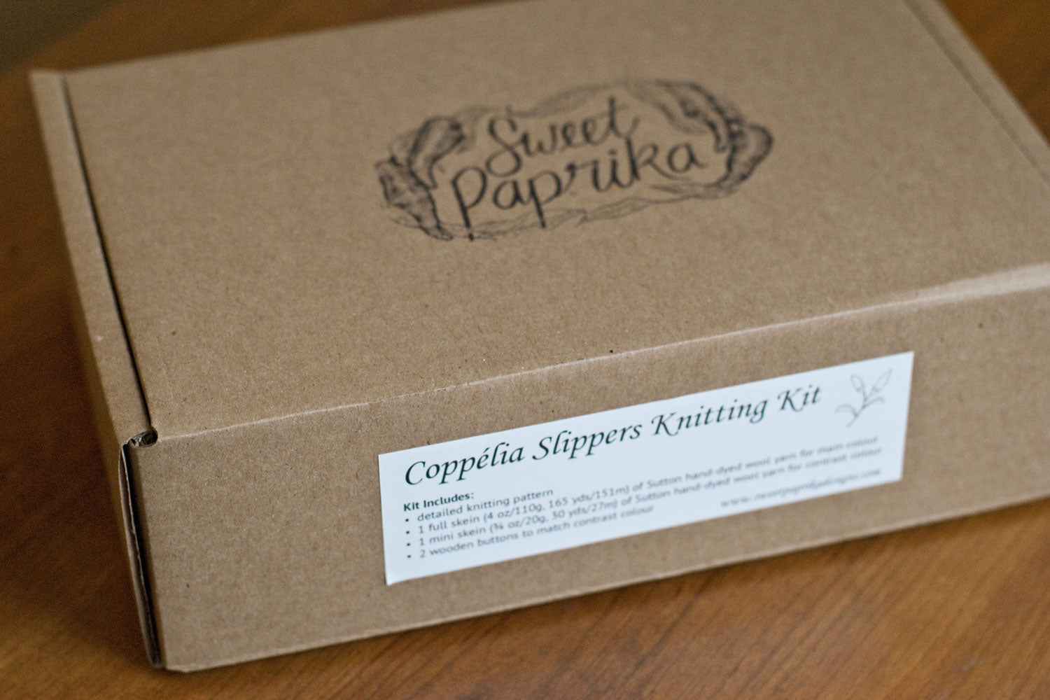 Cardboard box with sweet paprika stamp on top and slipper kit label on the side