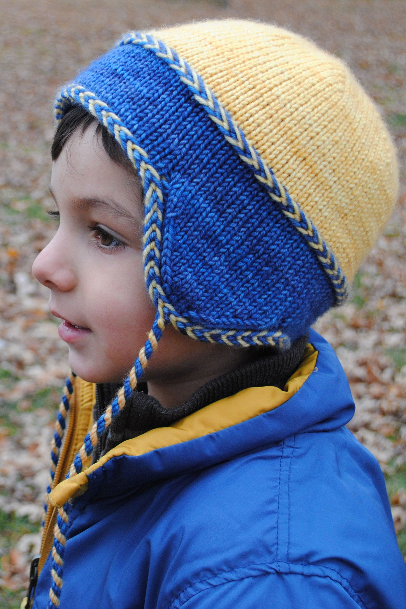 Little Leif reversible kids hat with Latvian braid