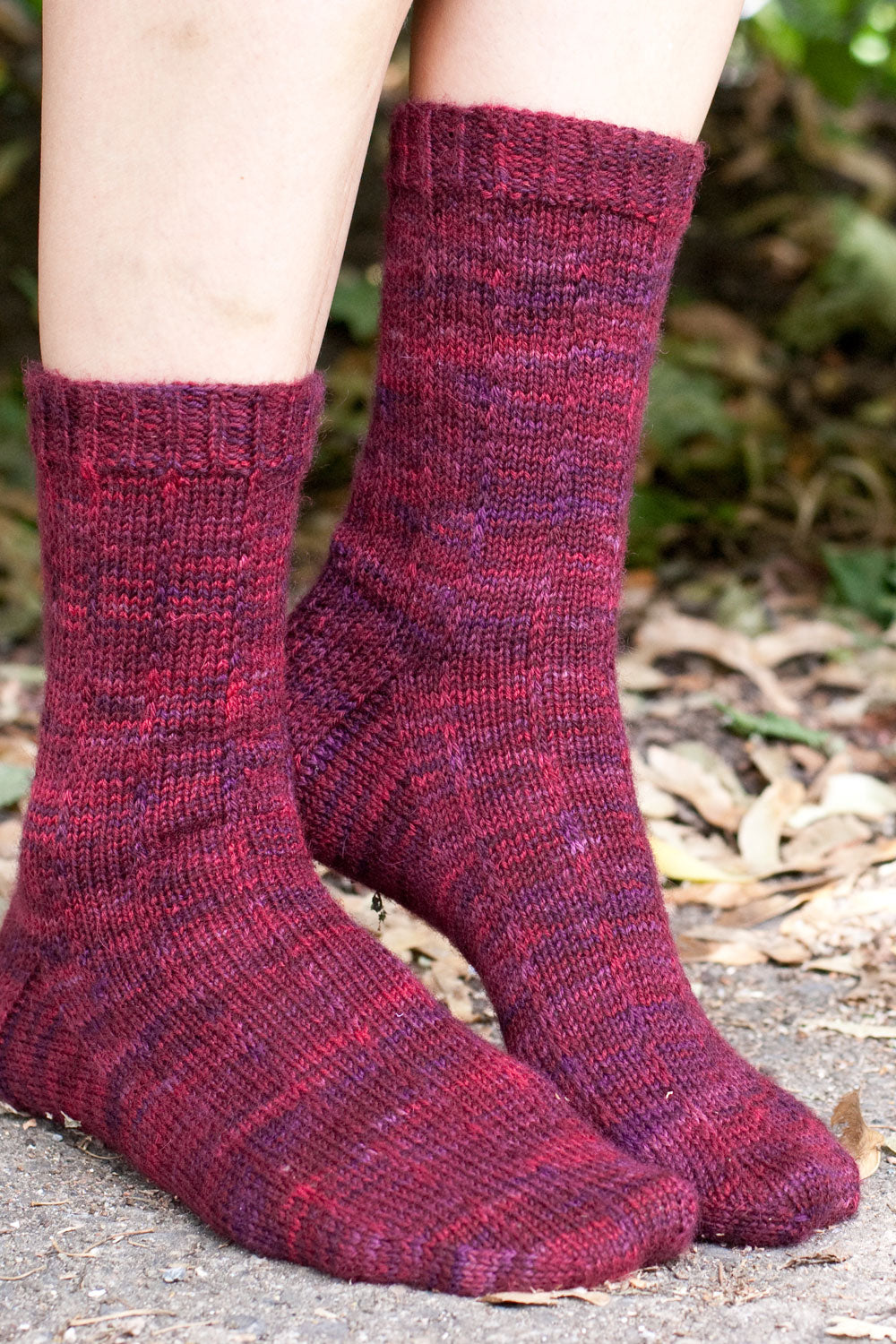 Socks knit with Pizzicato sock yarn in Palestra (purple/pink)