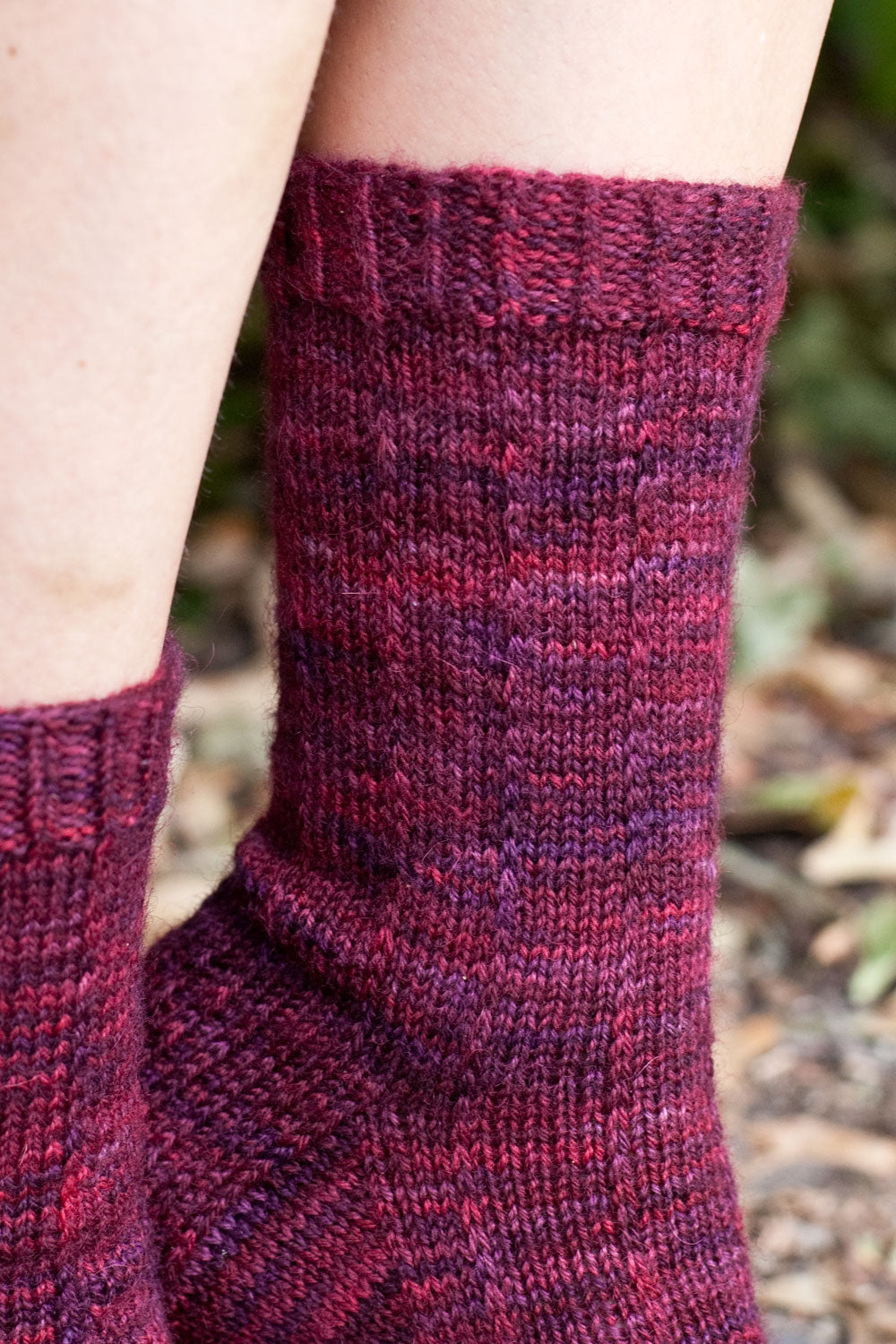 Cuff detail of pinstripe socks showing twisted rib