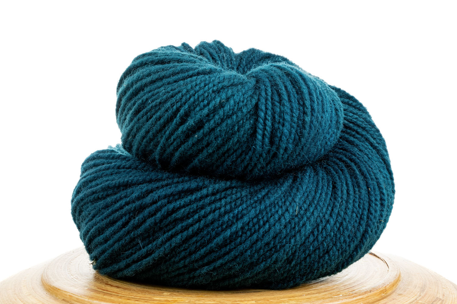 Winfield Canadian hand-dyed yarn in Enchanted River, a dark teal