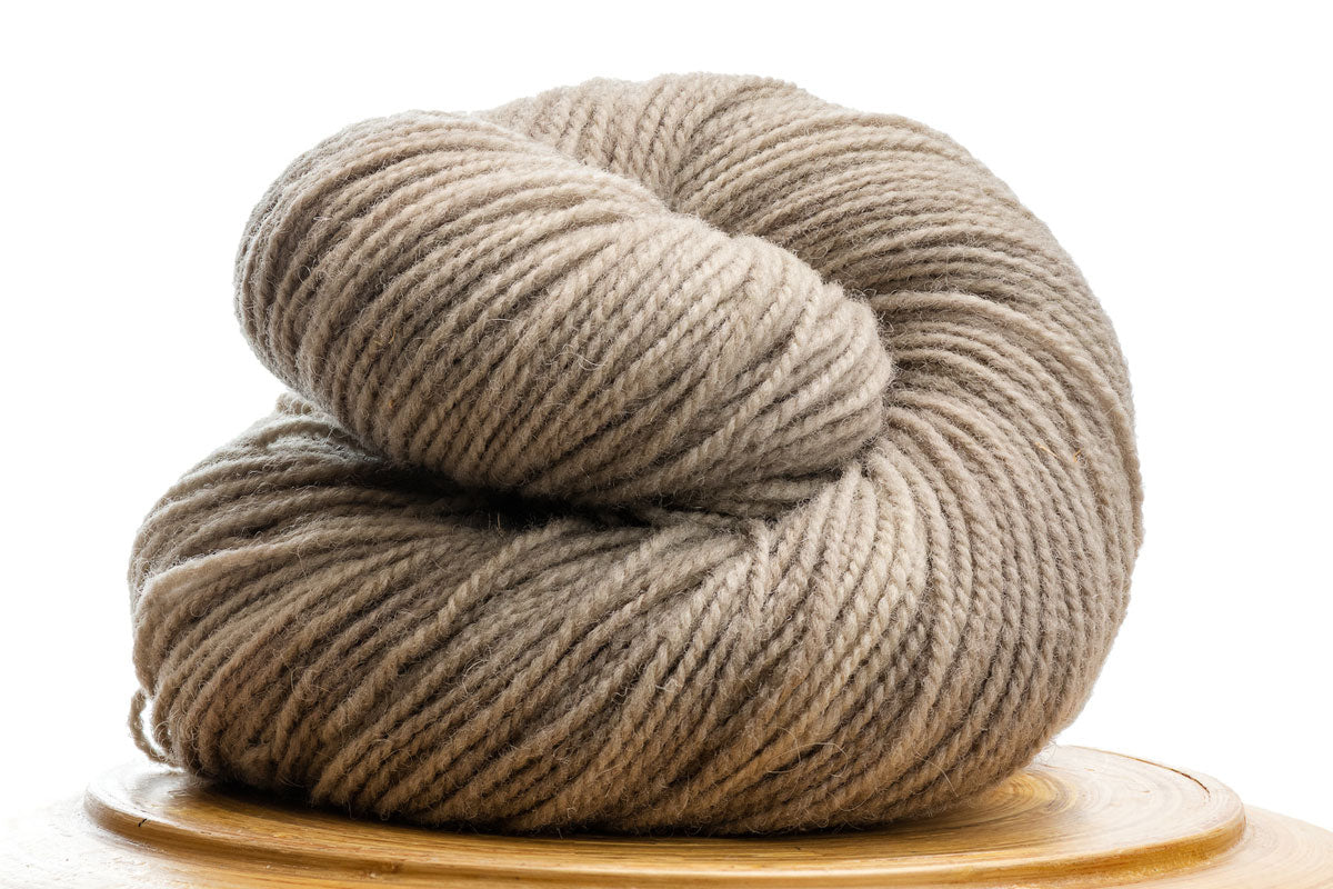 Winfield Canadian hand-dyed yarn in Shiitake, a pale warm neutral