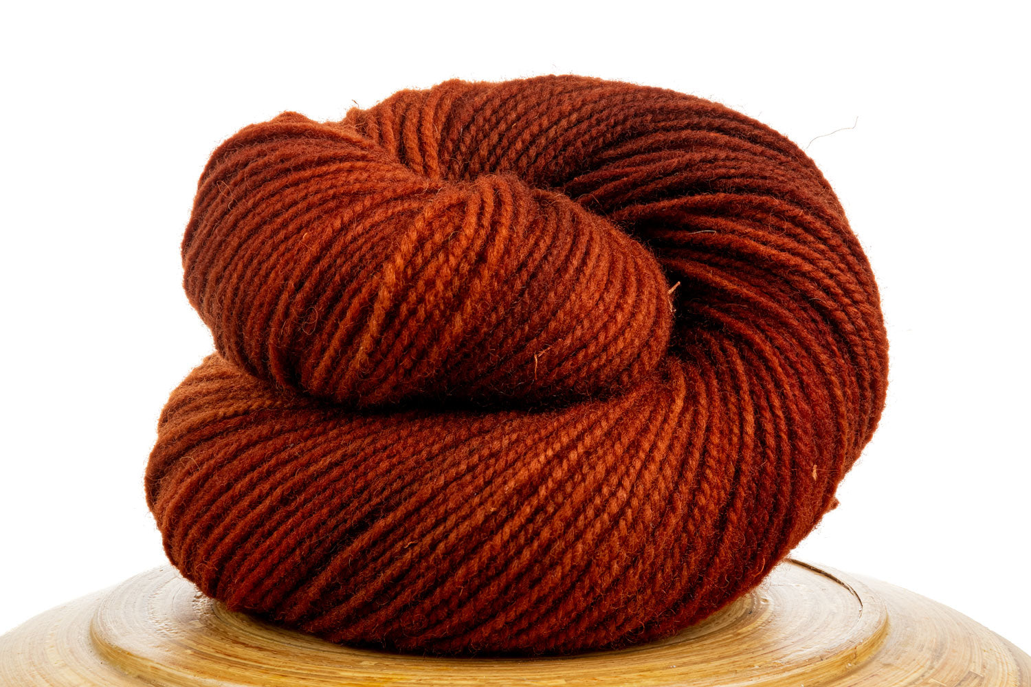 Winfield Canadian hand-dyed wool yarn in Sugar Maple, a deep orange