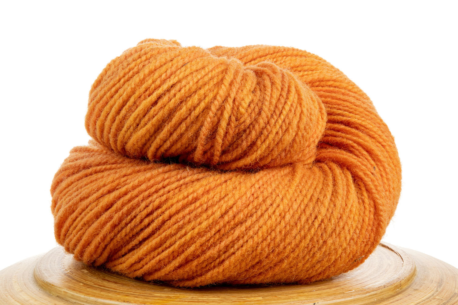 Winfield Canadian hand-dyed wool yarn in Zest, a bright orange