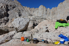 Urs Grutter sends us this picture of his cone cooking breakfast between Sky Blue Lake and Lake 12129 in the Mt. Whitney region of California.
