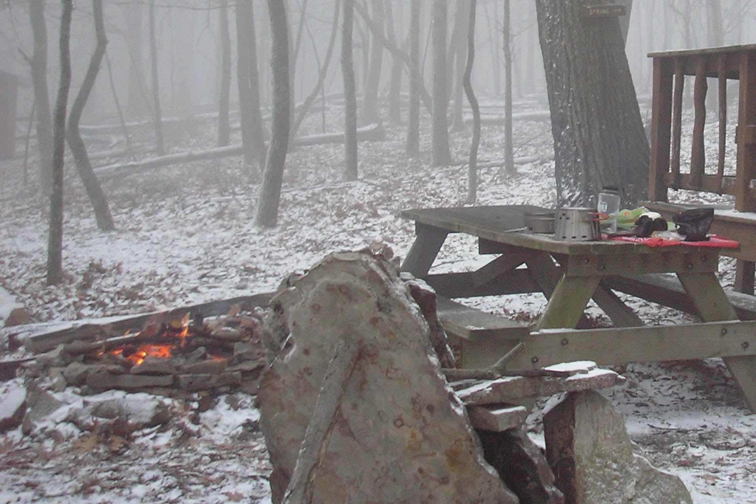 Gregory Marsh cooking a hot meal before hunkering down for a snow storm at Shockeys Knob Shelter on the Tuscarora Trail in West Virginia.