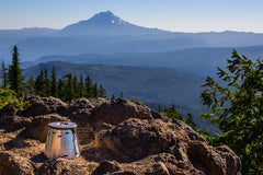 "Dudley Chelton also sends this shot looking the other direction at the Caldera posing in front of Mt. Jefferson. He notes: ""With my prior alcohol stove system, I'd have had to descend down into the trees to find a place out of the wind to cook dinner and breakfast. With the Caldera Cone windscreen, the alcohol stove didn't even know the wind was blowing on the summit."""