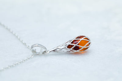 Caged Teardrop Amber Pendant