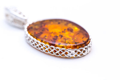 Oval Amber Pendant with Woven Knot Frame