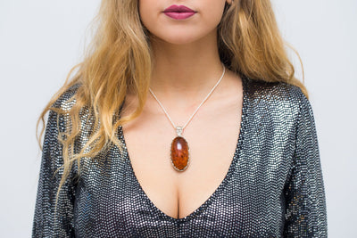 Unique Baltic Amber Pendant with Butterfly Frame