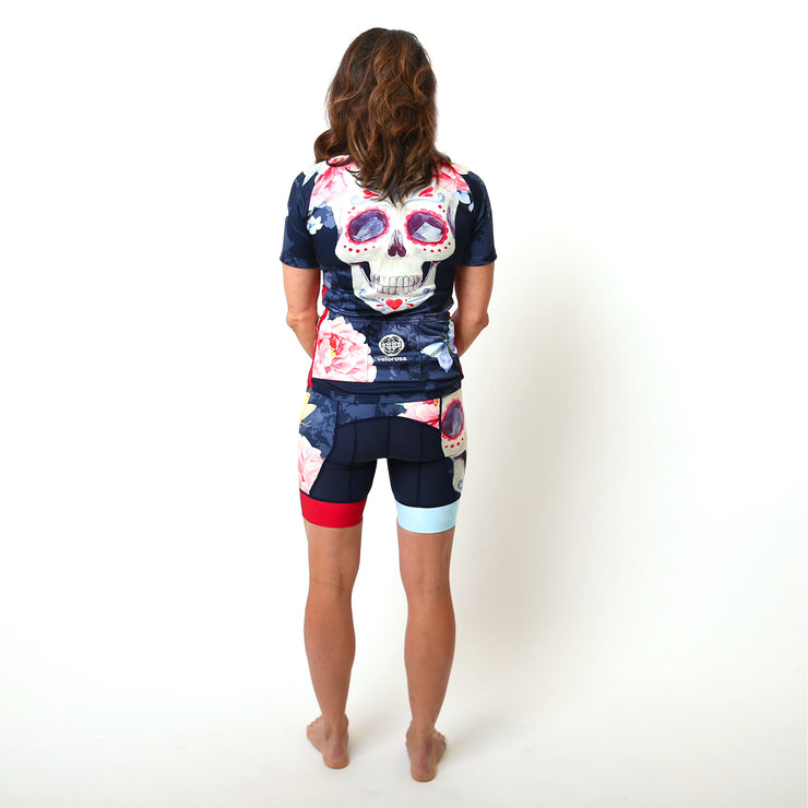 Model wearing Boneshaker Women's Short-Sleeved Biking Kit Back